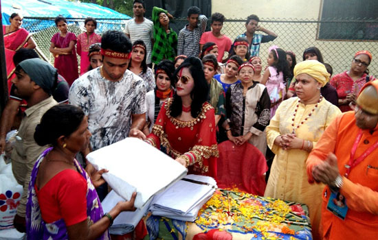 Shri Radhe Maa donates Tarpaulin sheets and food